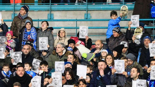 Napoli fans with pictures of Kalidou Koulibaly