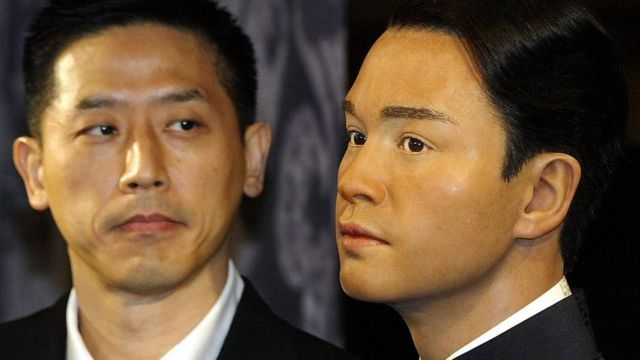 Daffy Tong, partner of Entertainer Leslie Cheung, looks at his waxwork unveiled at Madame Tussaud waxworks in Hong Kong, 31 March 2004. Leslie, Cheung one of Hong Kong's most acclaimed entertainers, leapt to his death 01 April 2003