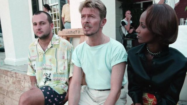 South African artist Beezy Bailey with David Bowie and Iman.