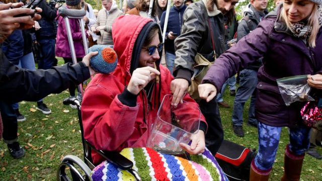 People contribute cannabis for a communal joint in Canada