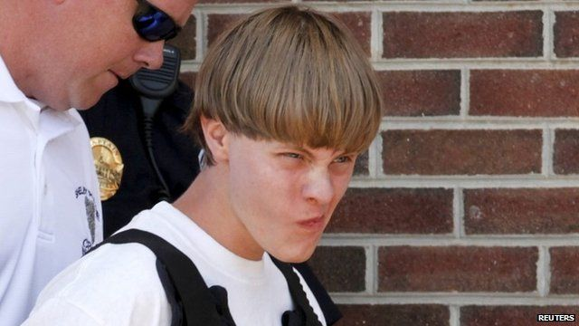 Police lead suspected shooter Dylann Roof, 21, into the courthouse in Shelby, North Carolina,