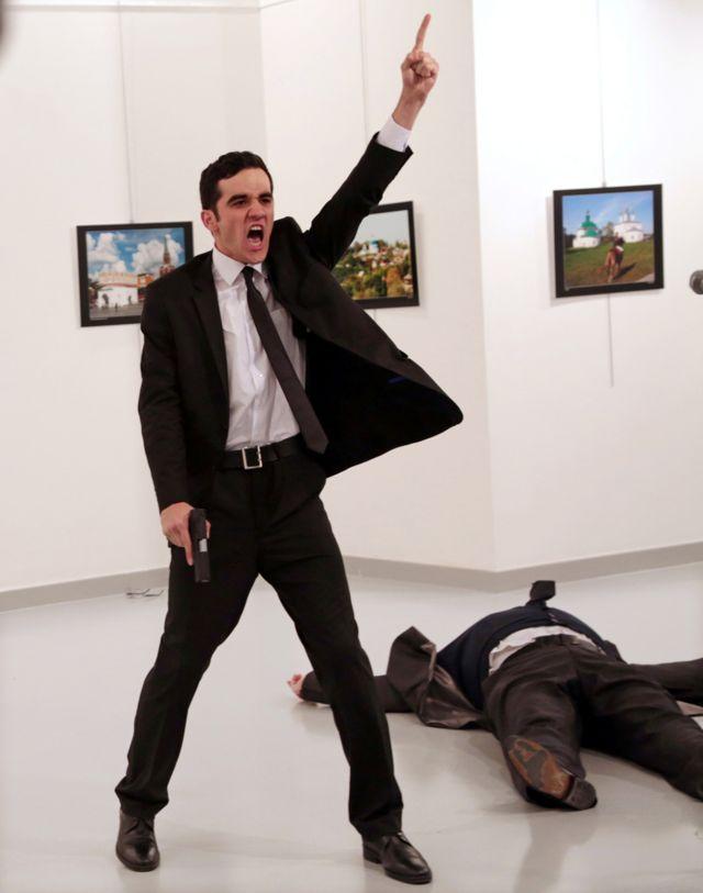 Mevlut Mert Altintas shouts after shooting Andrei Karlov the Russian ambassador to Turkey, at an art gallery in Ankara, Turkey, 19 December 2016.