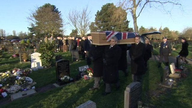 Mourners gathered behind Mr Davies' coffin