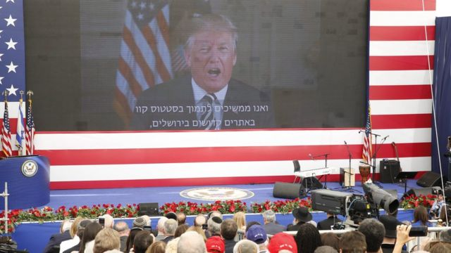 US President Donald J. Trump delivers remarks to the guests via a video connection during the opening ceremony at the US consulate that will act as the new US embassy in the Jewish neighborhood of Arnona, in Jerusalem, Israel