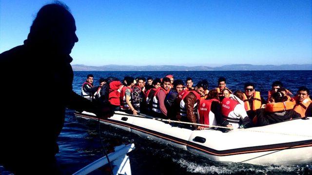 Migrantes en un barco