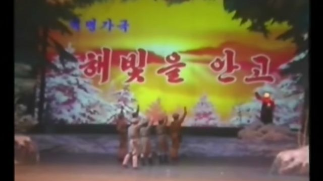 TV report of a local theatre performance of opera