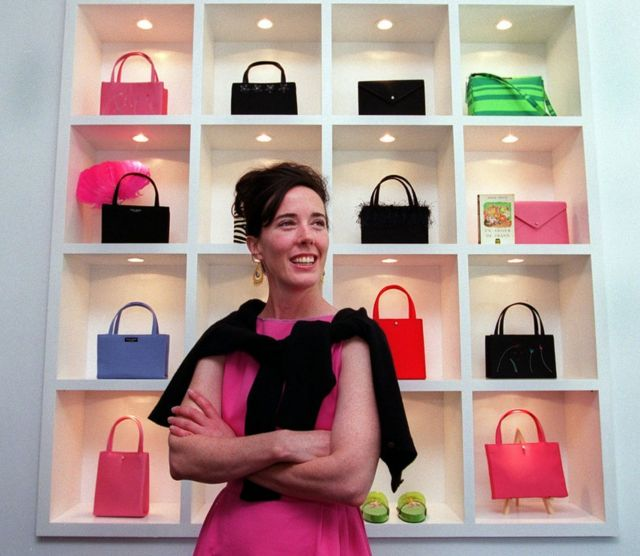 The fashion designer photographed amongst her handbags in 1999