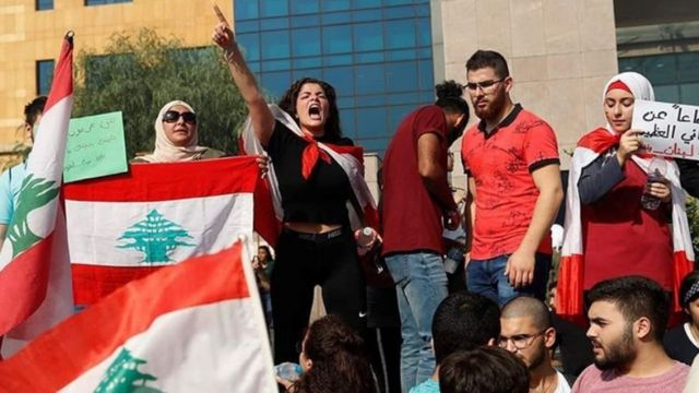 Nour Myra Jeha protesting in front of Lebanon's ministry of education