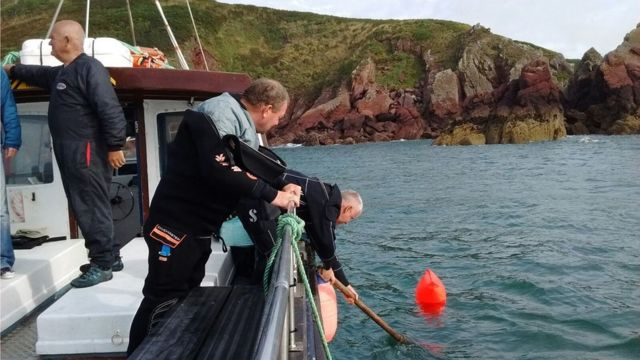 Diver surfaces with marine litter