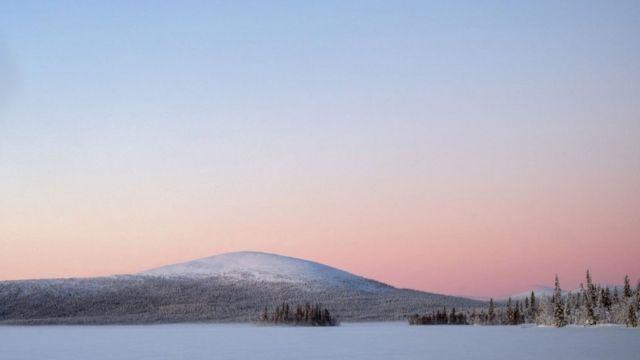 Sunrise over the frozen lake of Jeresjarvi on 20th February 2020 in Finnish Lapland