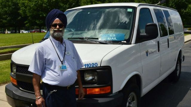 Sikh postman 'wins turban battle with Disney'