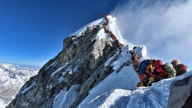 The viral photo from last month of two rows of climbers simultaneously ascending and descending close to Mount Everest's summit