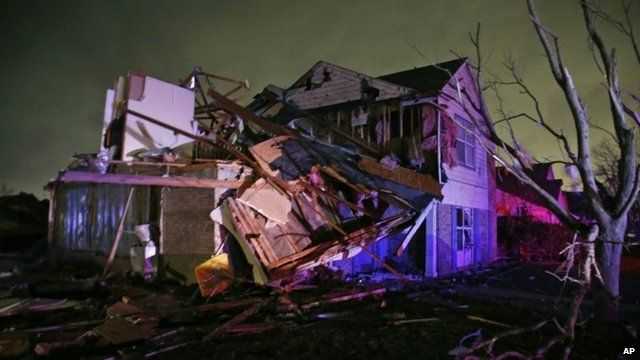 Debris lies on the ground near a home that was heavily damaged by a tornado in Rowlett, Texas