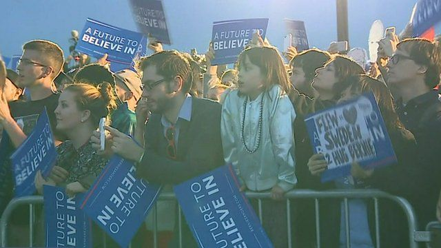 Young people with Bernie Sanders posters