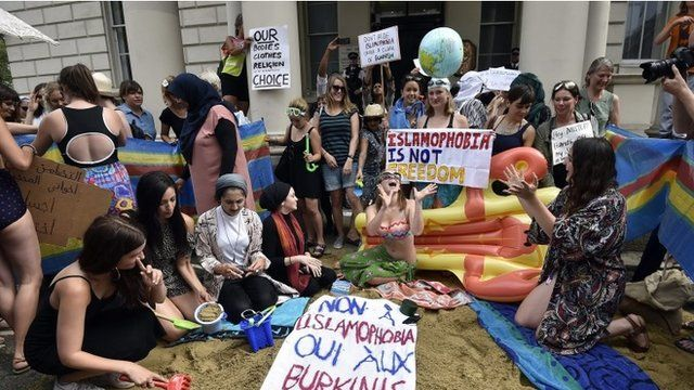 "People participate in a ""Wear what you want beach party"" protest outside of the French Embassy in"