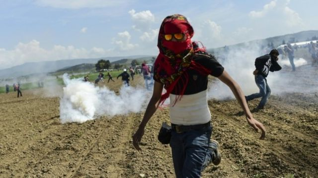 People fleeing clouds of tear gas
