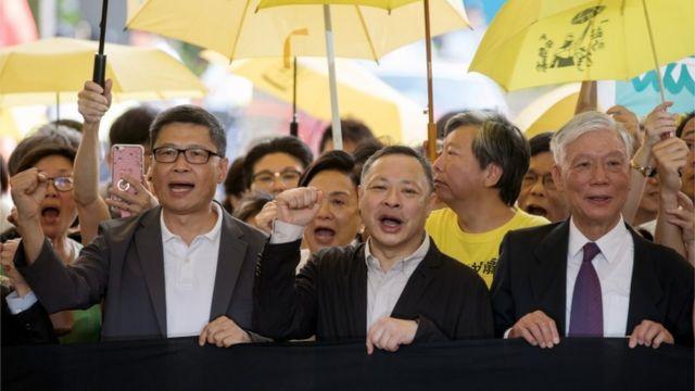Activists Chan Kin-man, Benny Tai, and Chu Yiu-ming outside court in Hong Kong ahead of their sentencing, April 2019