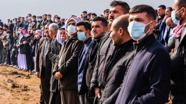 People gather for the mass funeral in Kocho on 6 February 2021