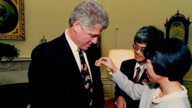 Masa (centre) and Mieko (right) Hattori meeting President Bill Clinton (left) in 1993