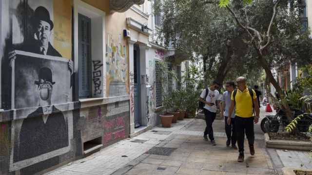 """Chinese tourists visit the Athens"""" historic district of Exarchia on September"""