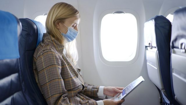 Woman travels by plane