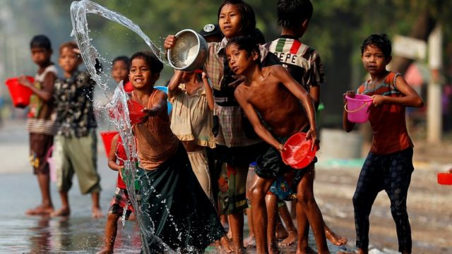 Children play with water during Water Festival outside Mandalay, April 13, 2017.