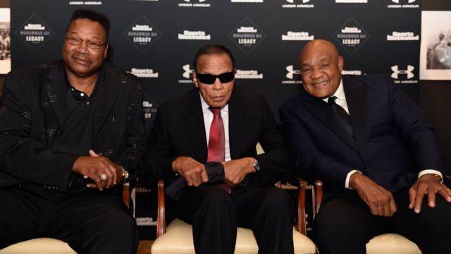 Larry Holmes, Mohamed Alí, y George Foreman
