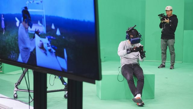 A press handout shows the crew testing the VR equipment ahead of filming