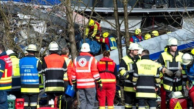 Rescue teams work at the site of a train accident near Bad Aibling, Germany