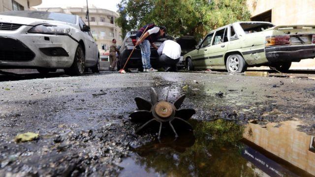 Последствия одного из взрывов в Дамаске в 2014 году