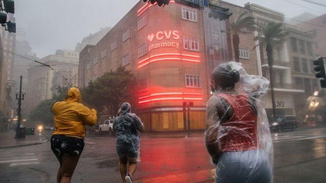people battle wind in New Orleans