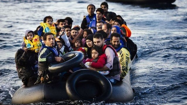 Migrants and refugees arrive on a dinghy on the Greek island of Lesbos, after crossing the Aegean sea from Turkey, on October 14, 2015