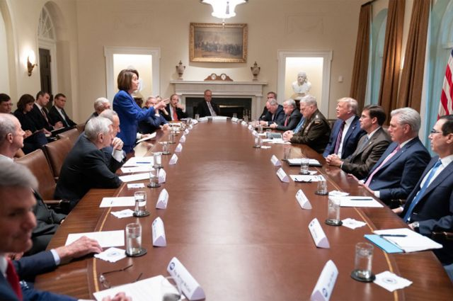 Nancy Pelosi stands up and points during an explosive meeting on Syria