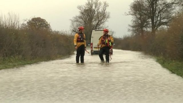 Firefighters from Shropshire Fire and Rescue with a vehicle in floodwater