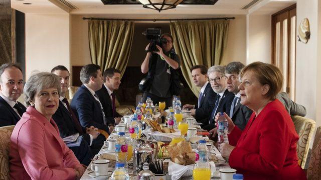 Theresa May and other Angela Merkel EU leaders in Sharm-el-Sheikh