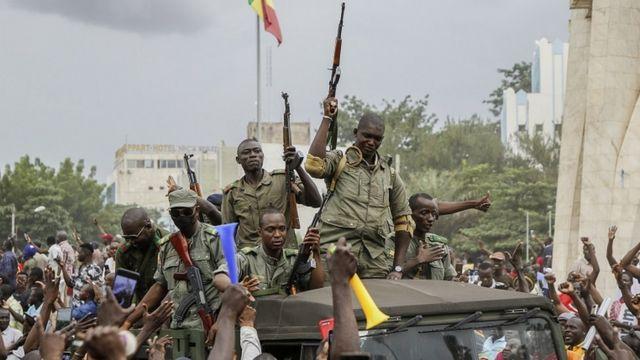 Malians cheer as Mali military enter the streets of Bamako, Mali, 18 August 2020.