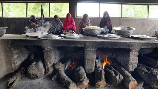 Women cook in the kitchen in Yerwa girls school in Maiduguri, Nigeria July 18, 2017.