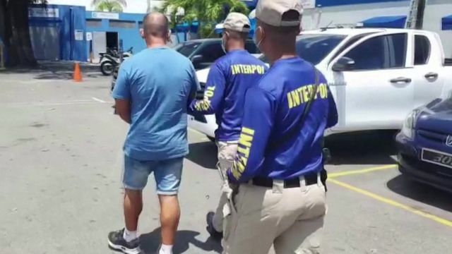 A man being led away by police