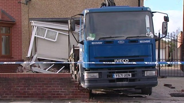 Lorry and damaged house in Lynton Gardens