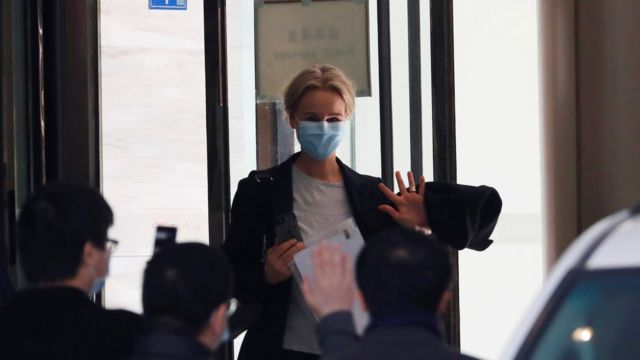 Thea Fisher, a member of the World Health Organisation (WHO) team tasked with investigating the origins of the coronavirus disease (COVID-19), waves as they leave their quarantine hotel in Wuhan, Hubei province, China January 28, 2021