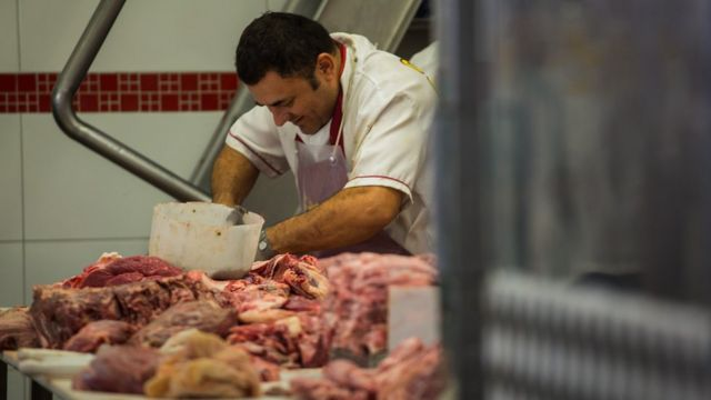 A butcher cuts meat at a butchery stall inside a market in Sao Paulo, Brazil, on Saturday, March 18, 2017.