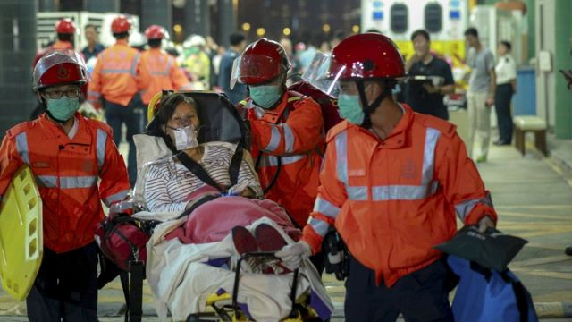 Passenger is carried off the ferry by emergency crews in Hong Kong (25 Oct 2015)