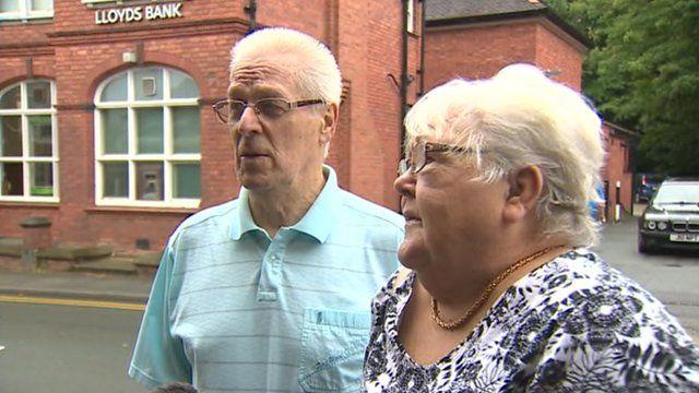 Couple outside Lloyds Bank in Hawarden