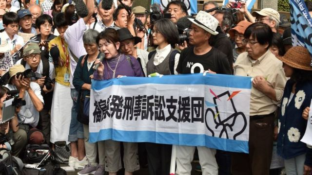 Activists outside a court in Tokyo following the trial of three Tepco executives over the Fukushima disaster 2019