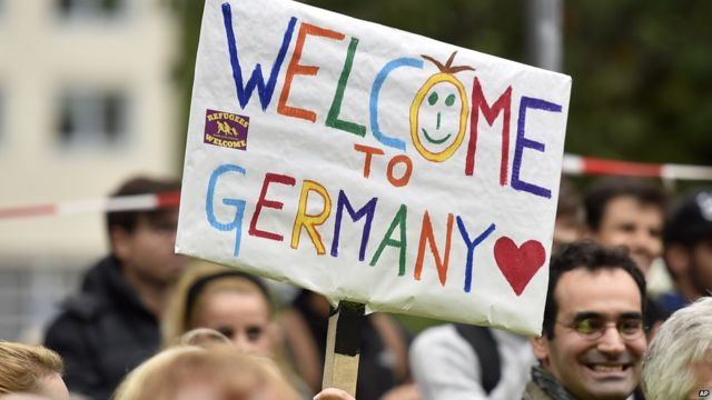 """A """"welcome to Germany"""" sign greets migrants"""