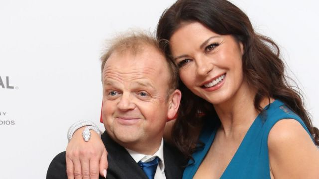 "Actors Toby Jones, left, and Catherine Zeta-Jones pose for photographers upon arrival at the World premiere of the film ""Dad""s Army"" at a central London cinema, Tuesday, Jan. 26, 2016."