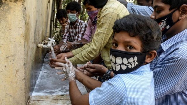 School children in India are washing their hands