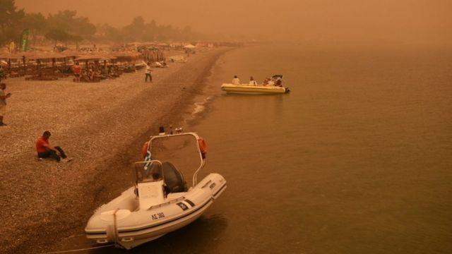 Smoke and orange sky on the Greek island of Evia.