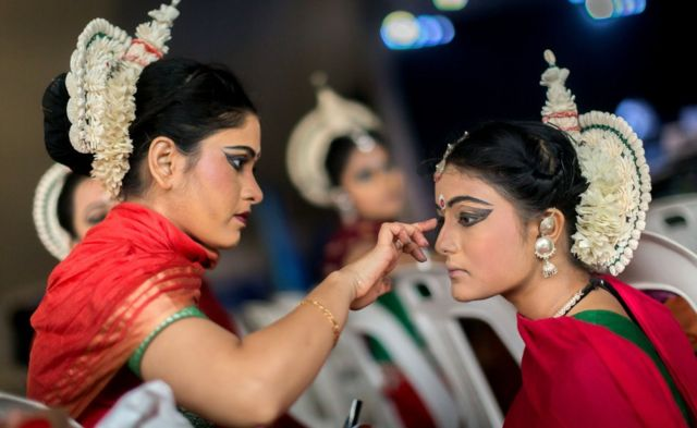 A group of colourful Odissi classical dancers from Kolkata, India do their final touch of make-up backstage before taking part on the two day Diwali (Festival of Lights) Hindu festival celebrations at the old Drive-Inn in Durban, on October 14, 2017. The two-day festival attracts over 100,000 visitors. The festival celebrations include, parading of floats, chariots, singing of devotional songs, dances, games, face painting, food stalls of vegetarian food, clothing, display of toys and jewellery. Young people also get the opportunity to showcase their cultural and spiritual talents