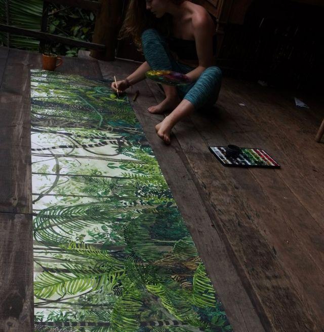 Jelly Green pintando imagem de floresta no Brasil
